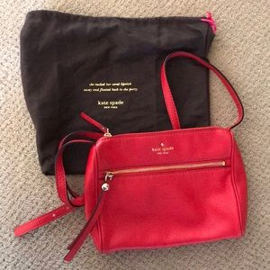 Red Kate Spade over the shoulder purse.